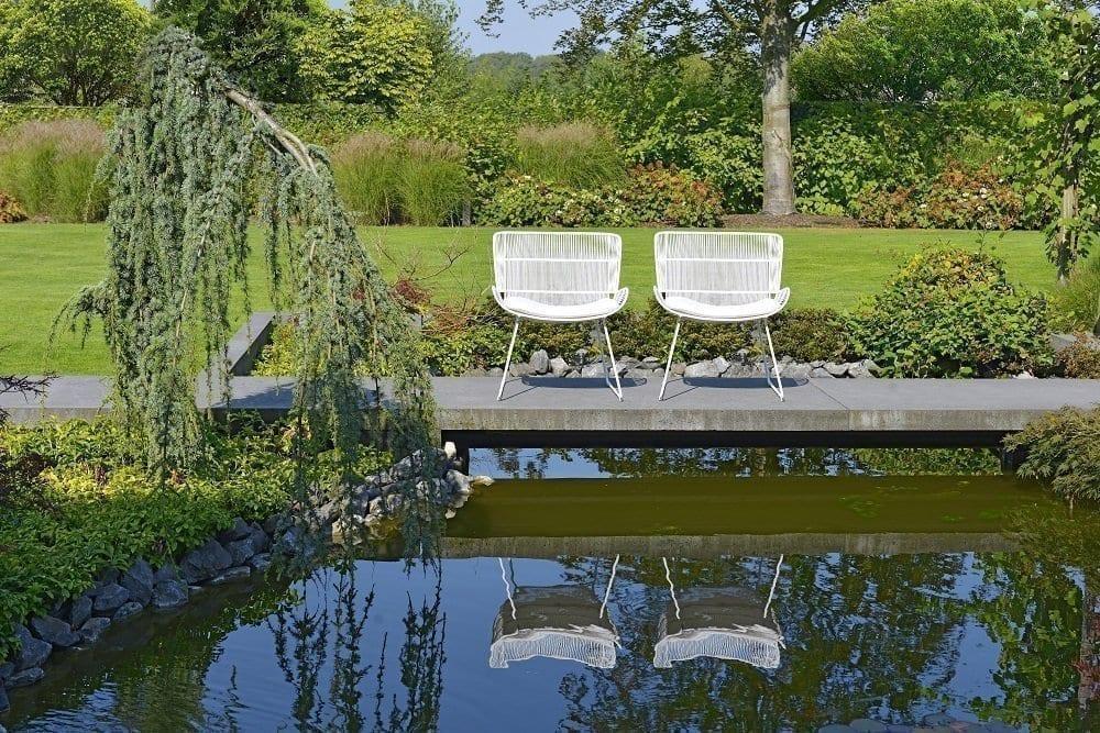 White Faye lounge chairs | Max & Luuk
